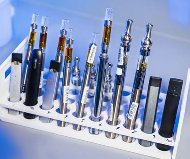 e-cigarettes and vape pens in a container