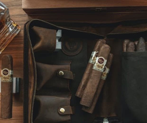 Cigars on a table and in a leather bag