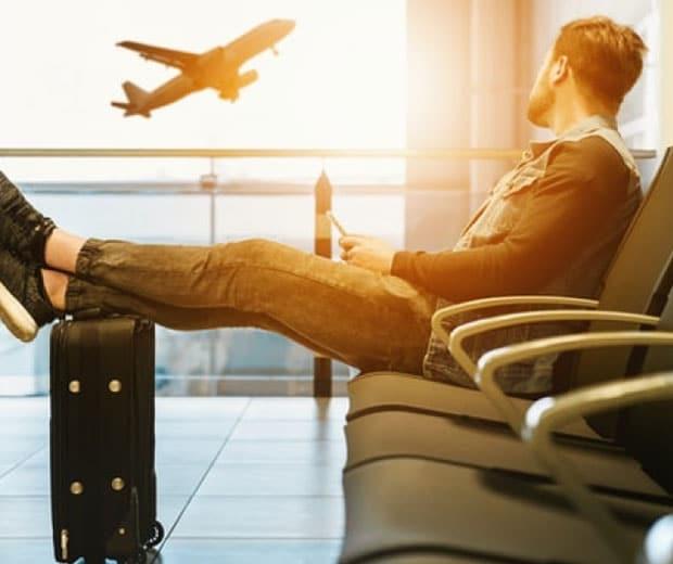 Man at airport watching a plane
